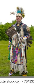 OTTAWA, CANADA - MAY 28: Unidentified aboriginal young man in full dress and head regalia during the Powwow festival at Ottawa Municipal Campground in Ottawa Canada on May 28, 2011.