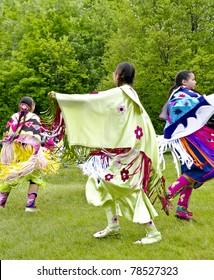 OTTAWA, CANADA - MAY 28: Unidentified aboriginal women dancers in full dress regalia during the Powwow festival at Ottawa Municipal Campground in Ottawa Canada on May 28, 2011.