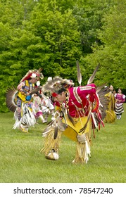 OTTAWA, CANADA - MAY 28: Unidentified aboriginal dancers in full dress and head regalia during the Powwow festival at Ottawa Municipal Campground in Ottawa Canada on May 28, 2011.