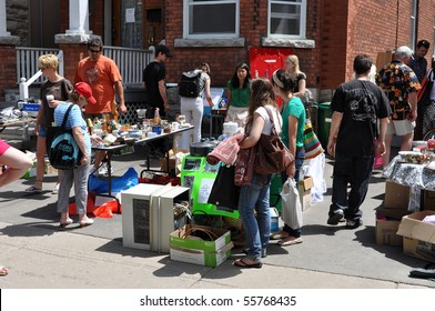 OTTAWA, CANADA - MAY 29: Thousands of people gather at the annual Glebe neighborhood garage sale which takes place for several blocks in the Glebe area of Ottawa, Ontario May 29, 2010.