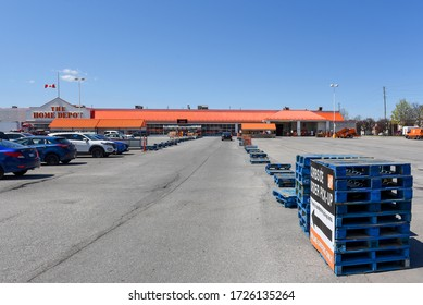 Ottawa, Canada – May 7, 2020: Home Depot store on Baseline Rd with barriers set up for cars to use curbside order pickup, as part of coronavirus lockdown measures in Ontario.