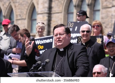 OTTAWA, CANADA - May 9, 2013: Gerald Lacroix, the Archbishop of Quebec and Primate of Canada speaks at an anti-abortion rally on Parliament Hill. He was appointed a Cardinal in February 2014.