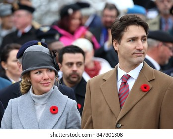 OTTAWA, CANADA - NOVEMBER 11, 2015: New Canadian Prime Minister Justin Trudeau and wife, Sophie Gregoire Trudeau, place a wreath at Remembrance Day ceremonies in Ottawa.