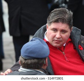 OTTAWA, CANADA - NOVEMBER 11, 2016: Canadian Minister of Veterans Affairs, Kent Hehr, chats with veterans at the Remembrance Day ceremony at the National War Memorial.