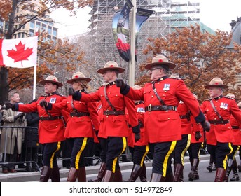 OTTAWA, CANADA - NOVEMBER 11, 2016: Members of the Royal Canadian Mounted Police march past the reviewing stand following the Remembrance Day ceremony at the National War Memorial.