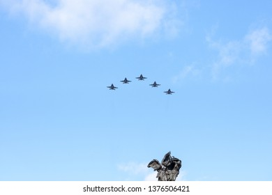 OTTAWA, CANADA - NOVEMBER 11, 2018: Royal Canadian Air Force (RCAF) fighter jet planes flying in formation above the statue of the National War Memorial on remebrance day
