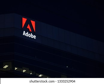 OTTAWA, CANADA - NOVEMBER 12, 2018: Adobe logo, in front of one of their main office for Ottawa, Ontario. Adobe is a computer software editor famous for his multimedia editing suites