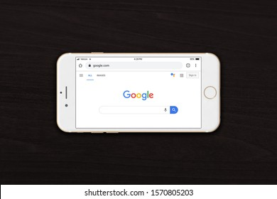 Ottawa, Canada - November 24, 2019: Google (a search engine website) on Google Chrome app displayed on iPhone or smartphone with wooden background. Illustrative image.