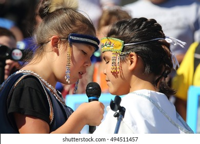 OTTAWA, CANADA - OCTOBER 4, 2016: Young Inuit throat singers perform on Parliament Hill Oct. 4 at a vigil honoring missing and murdered Indigenous women.
