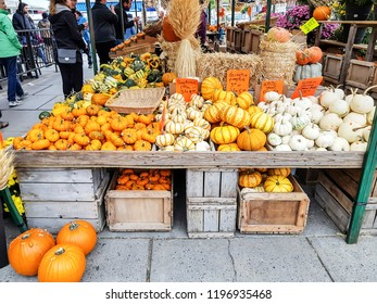 OTTAWA, CANADA  - OCTOBER 6, 2018: Market stall displaying squash in the Byward market in Ottawa. The Byward market is Canada's oldest continuously operating farmers' market
