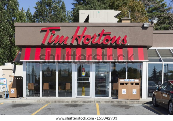 OTTAWA, CANADA - SEPTEMBER 16: A Tim Hortons outlet September 16, 2013, Ottawa, Canada. Tim Hortons has 4,288 restaurants, 3,453 in Canada, 808 in the US and 27 in the Gulf Cooperation Council.