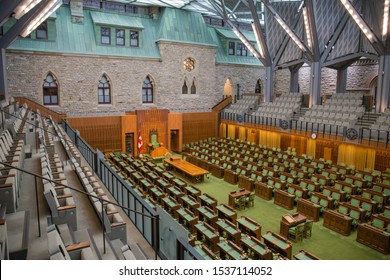 OTTAWA, CANADA - SEPTEMBER 22, 2019: Rows of traditional green leather desks and chairs fill the new House of Commons of the Parliament of Canada in the historic West Block building in Ottawa, Canada.