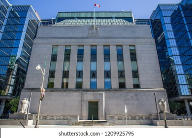 OTTAWA, CANADA - SEPTEMBER 9, 2018: Viewed from a street, the original, historic Bank of Canada building stands between the new Bank of Canada glass office towers in downtown Ottawa.