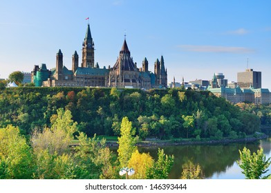 Ottawa cityscape in the day over river with historical architecture.