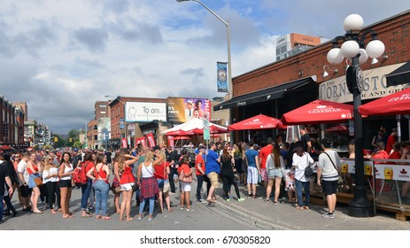OTTAWA, JUL 1, 2017: People lineup to get into the Cornerstone Bar and Grill on Clarence St on Canada Day in the Byward Market.  Crowds were larger due to this being  the 150th anniversary.