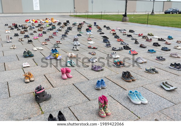 OTTAWA - JUNE 11, 2021: Photos show memorial around Centennial Flame at Parliament Hill to honour the lives of 215 indigenous children whose remains were found in a mass grave in Kamloops, BC, Canada.