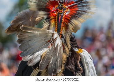 OTTAWA - JUNE 24, 2017: A close up and detailed view of the back of a Pow Wow dancer's colourful outfit at the 2017 Ottawa Summer Solstice Indigenous Festival at Vincent Massey Park.