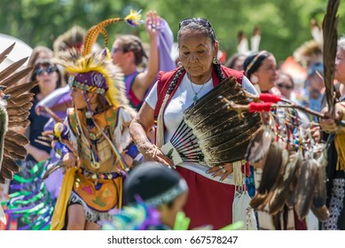 OTTAWA - JUNE 24, 2017: An elder surrounded by youthful and cheerful members of her indigenous community at the 2017 Ottawa Summer Solstice Indigenous Festival at Vincent Massey Park.