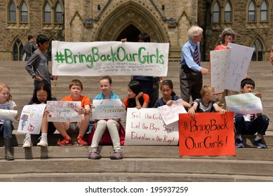 OTTAWA - MAY 22:  School children gather for a rally to activate governments to rescue the girls in Nigeria and protect school girls across the world on Parliament Hill  May 22, 2014 in Ottawa, Canada