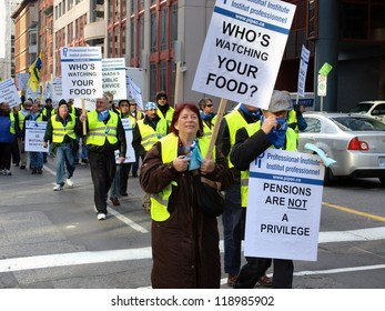 OTTAWA - NOVEMBER 16: Members of the Professional Institute of the Public Service of Canada (PIPSC) union demonstrate against Canadian federal job cuts, along Queen St. in Ottawa on November 16, 2012