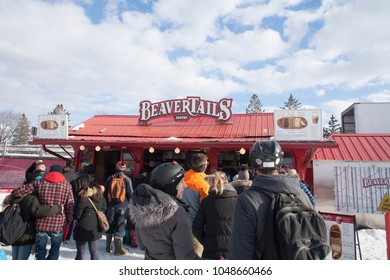 Ottawa, ON / Canada February 17 2018 People line-up at a Beavertails stand on the Rideau Canal. Last day of season for 2017/2018