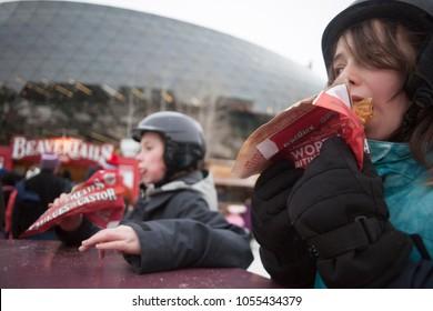Ottawa, ON / Canada February 17 2018 kids eating beavertails on the Rideau Canal.