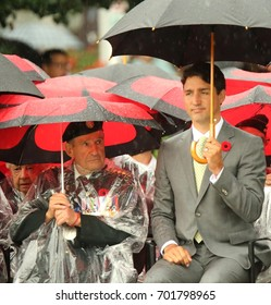 OTTAWA, ONTARIO - AUGUST 23, 2017: Prime Minister Justin Trudeau takes part in a ceremony in the pouring rain at the National War Memorial marking the Dieppe Raid.
