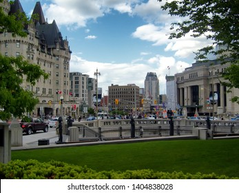 Ottawa, Ontario / Canada - 06/01/2017 - View from The National War Memorial looking towards Elgin St (taken from Wellington St). Active street view of city, pedestrians, traffic, and overcast sky.