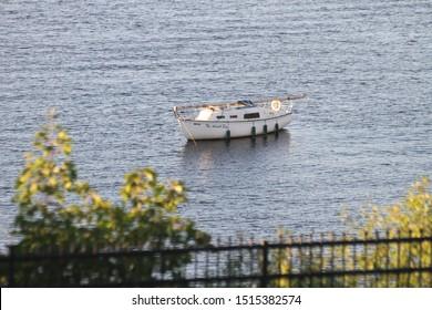 Ottawa Ontario Canada / August 31 2019. A Summer sunset photo I took of a boat on the Ottawa river, Ottawa, Ontario, Canada.