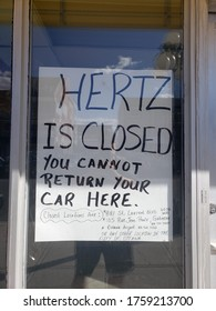 Ottawa Ontario Canada / June 14 2020: Hertz rent a car window information sign stating Hertz is closed you cannot return your car here.