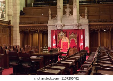 Ottawa, Ontario, Canada - June 28, 2018:  Throne in Senate Chamber in Centre Block building on Parliament Hill, home of Canada's federal government.