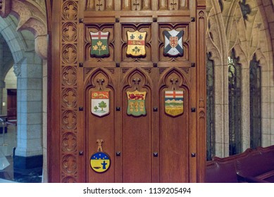 Ottawa, Ontario, Canada - June 28, 2018:  Senate Chamber west door with provincial shields in Centre Block building on Parliament Hill, home of Canada's federal government.