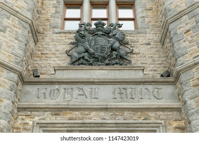 Ottawa, Ontario, Canada - June 30, 2018:  Above main entrance of Royal Canadian Mint building, including Royal Coat of Arms.