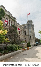 Ottawa, Ontario, Canada - June 30, 2018:  Looking toward main entrance of Royal Canadian Mint building in summer, home of specialty gold and silver coin production, vertical orientation.