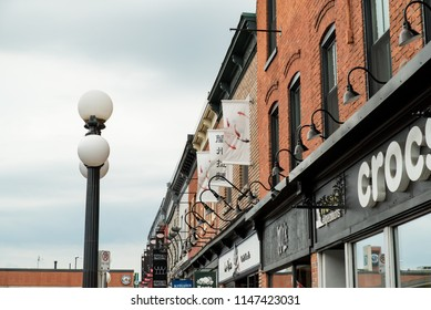 Ottawa, Ontario, Canada - June 30, 2018:  Storefront signs in Byward Market district along William Street.