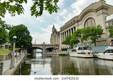 Ottawa, Ontario, Canada - June 30, 2018:  Rideau Canal in summer, looking northwest toward Fairmont Chateau Laurier at middle and Government Conference Centre at right.