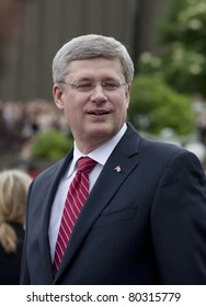 OTTAWA, ONTARIO, CANADA - JUNE 30: Prime Minister Stephen Harper greets the crowd while waiting for the Duke and Duchess of Cambridge to arrive.on June 30, 2011 in Ottawa, Ontario, Canada.