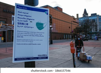 OTTAWA, ONTARIO, CANADA - NOVEMBER 18, 2020: A multilingual 'mask required' sign posted by Ottawa Public Health informs pedestrians of a COVID-19 prevention by-law in several languages.