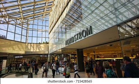 Ottawa,  Ontario -  September 2017 -  Shoppers in the CF Rideau Centre Shopping Mall Walk by Nordstrom Retail Store
