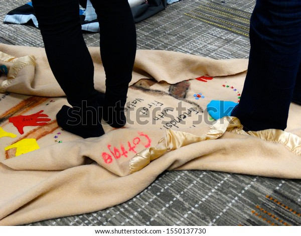 Ottawa, Ontario/Canada - 06/01/2015: People participating in a KAIROS Blanket Exercise at a final Truth and Reconciliation Commission event.