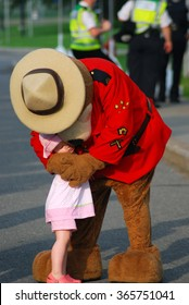 Ottawa,Ontario Canada-June 26, 2008:Police Mascot with Young Girls Dressed in Pink