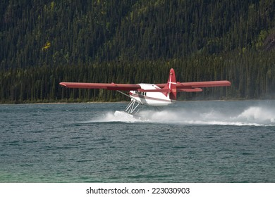 Otter Float plane taxiing at Muncho Lake, northern British Columbia, Canada