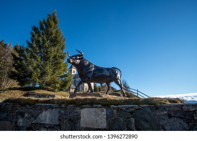 ottmanch, carinthia / austria - 04 06 2019:magdalensberg mountain view with bull statue in front