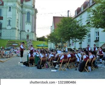 Ottobeuren, Bavaria / Germany - June 2017: Traditional Bavarian brass band including alphorn musicians in the city center