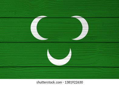 Ottoman Tripolitania 18th century flag color painted on Fiber cement sheet wall background. Three white crescent on green.