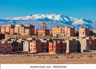 Ouarzazate city and High Atlas Mountains aerial panoramic view, Morocco. Ouarzazate is a city and capital of Ouarzazate Province near Marrakech in Morocco.