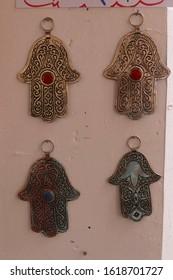 OUARZAZATE, MOROCCO - FEB 17, 2019 - Metalwork hands of Fatima pendants, Kasbah Taourirt, Ouarzazate,  Morocco, Africa