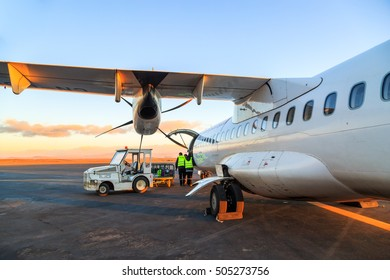 Ouarzazate, Morocco - Feb 28, 2016: agents of the airline charges passengers' luggages in the hold of the airliner at daybreak