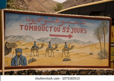 Ouarzazate/ Morocco - july 25 2008: Funny direction sign to show to way to Timbuktu in South Morocco.