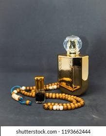 Oud attar arabian perfume, agarwood oil fragrances in mini bottle and Oil Perfume In A Beautiful golden Jar Bottle and Glass